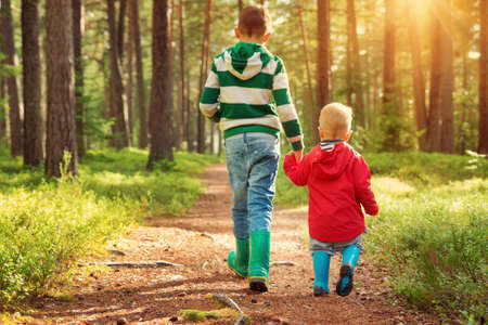 Children walking in the forest