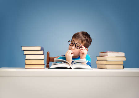 seven years old child reading a book