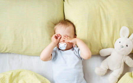 One year old baby in the bed Stock Photo