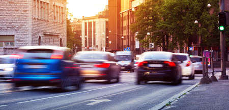 Cars moving on the urban road at dusk