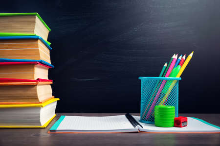 school accessories on the table with blackboard background 版權商用圖片