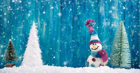 little snowmans on soft snow Stock Photo