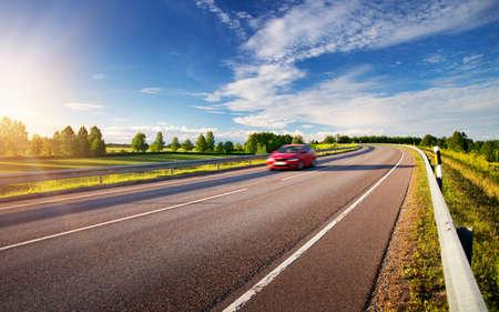 car moving on sunny evening 版權商用圖片