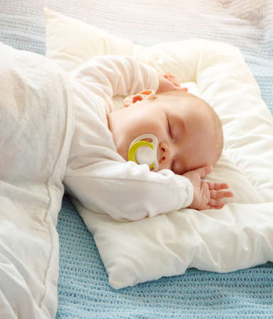 Baby sleeping covered with soft white blanket Archivio Fotografico - 107488826