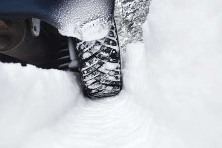Closeup of car tires in winter after snowfall Stock Photo