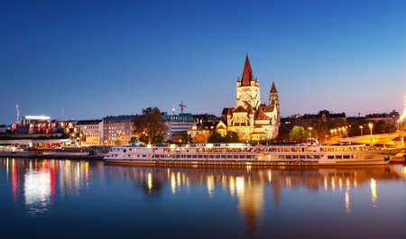 Saint Francis of Assisi Church on Danube in Vienna, Austria at night 写真素材