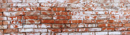 Rustic red brick background with white paint