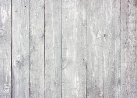 Gray wooden background with old painted boards