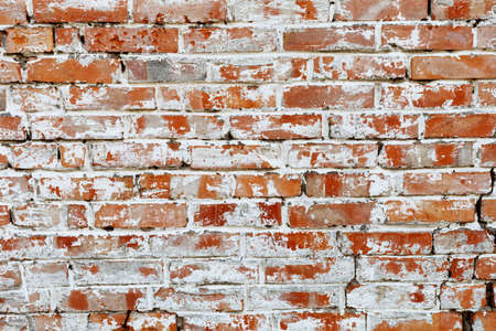 Rustic red brick background with white paint. Dirty wall pattern of an old building. Brickwall texture Zdjęcie Seryjne