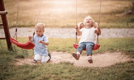 Boy and boy playing on the backyard