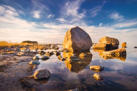 Rocks at seaside in Kasmu village on beautiful evening Stock fotó