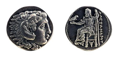 rare: Greek silver tetradrachm from Alexander the Great showing Hercules wearing lion skin at obverse and Zeus at reverse, dated 323-315 BC.  Stock Photo