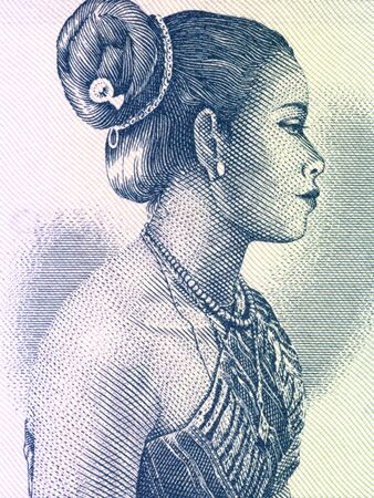 unc: Beautiful woman on 10 kip 1962 banknote from Laos Stock Photo