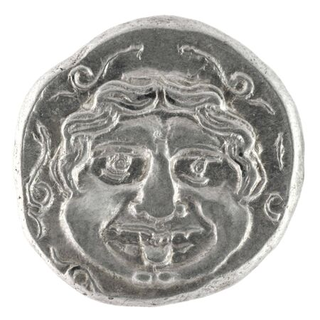 greek currency: Medusa on ancient Greek half drachm from 300 BC  Stock Photo