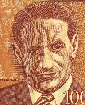 populist: Jorge Eliecer Gaitan (1903-1948) on 1000 Pesos 2006 Banknote from Colombia. Politician and leader of a populist  movement in Colombia.
