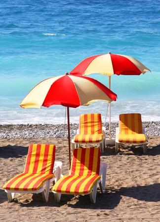 Beach chairs and umbrellas on a sand beach  photo