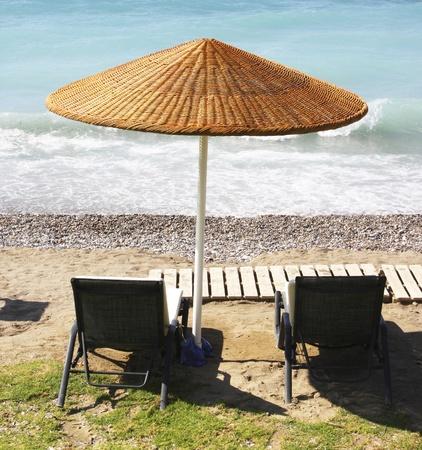 rhodes: Beach chairs and umbrella on a beach