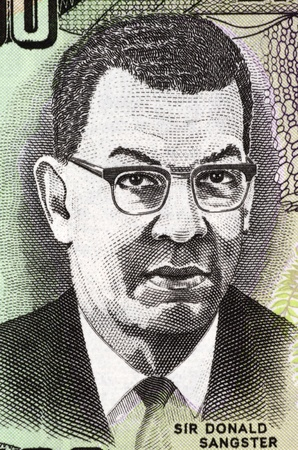 banknote uncirculated: Donald Sangster (1911-1967) on 100 Dollars 2007 Banknote from Jamaica. Jamaican politician and the second Prime Minister of Jamaica.