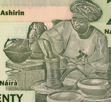 banknote uncirculated: Potter on 20 Naira 2009 Banknote from Nigeria. Stock Photo
