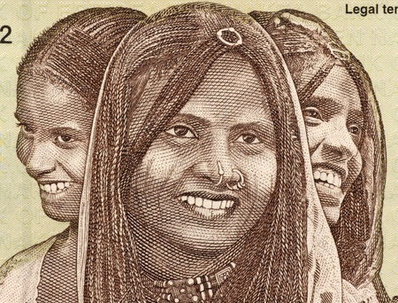 banknote uncirculated: Three Young Women on 10 Nakfa 1997 Banknote from Eritrea. Stock Photo