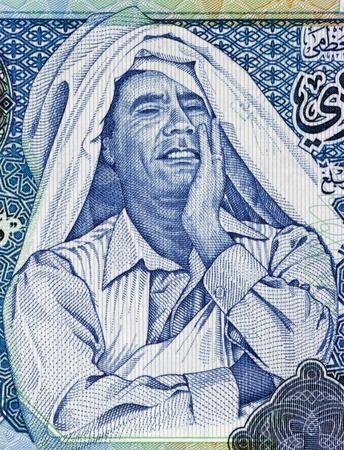 arabic currency: Muammar Gaddafi  1942-2011  on 1 Dinar 2004 Banknote from Libya  Ruler of Libya during 1969-2011