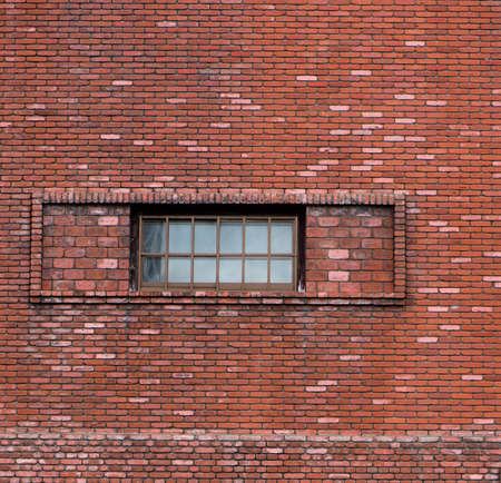 ammonium: Window on the red wall,pattern brick block,in Sapporo Japan. Stock Photo