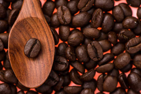 Preview Save to a lightbox  Find Similar Images  Share Stock Photo: Coffee beans in wood spoon with background of coffee beans.
