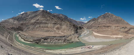 Panorama Scenic view of Confluence of Zanskar river from left and Indus rivers from up right - Leh, Ladakh, Jammu and Kashmir, India. tourist spot, all seasons. landscape, scenic, beautiful, aerial view Reklamní fotografie