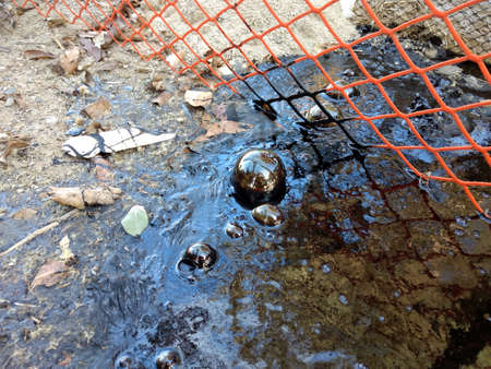 Sphere bubbling up in  Santa Barbara County oil seepage Stock Photo
