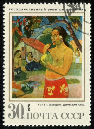 USSR - CIRCA 1970: A stamp printed in the USSR shows a painting by the artist Paul Gauguin The woman holding a fruit, circa 1970.