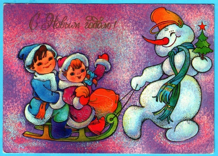 USSR - CIRCA 1991: Postcard printed in the USSR shows draw by Chymicheva - Snowman lucky children on sleds, circa 1991. Russian text: Happy New Year!