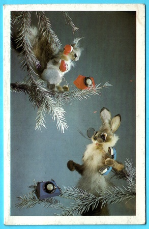 USSR - CIRCA 1987: Postcard printed in the USSR shows draw by Kypriyanova - rabbit with a squirrel on the tree talking on the phone, circa 1987 Stock Photo - 13574958