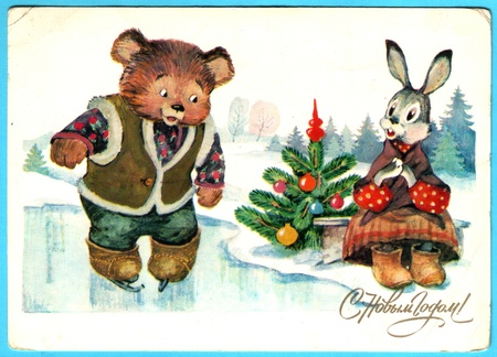 USSR - CIRCA 1985: Postcard printed in the USSR shows draw by Ozhogova - Bear and the Hare, skating near the tree, circa 1985. Russian text: Happy New Year! Stock Photo - 13574952
