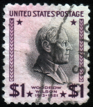 wilson: UNITED STATES OF AMERICA - CIRCA 1938: a stamp printed in the United States of America shows Woodrow Wilson, 28th President of USA 1913-1921, circa 1938