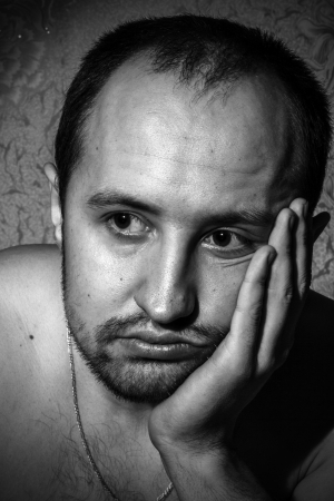 A young man  Thoughtful and unshaven  Black and white portrait photo