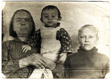 USSR  - CIRCA 1948: An antique photo shows mother with two children 新聞圖片