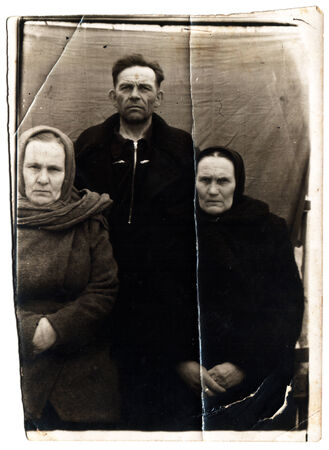 studio b: USSR  - CIRCA 1950s: An antique photo shows man and two women Editorial