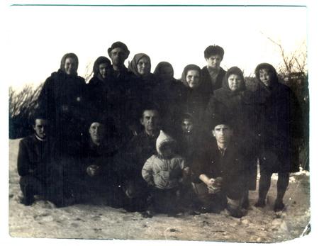 studio b: USSR  - CIRCA 1950s: An antique photo shows group portrait