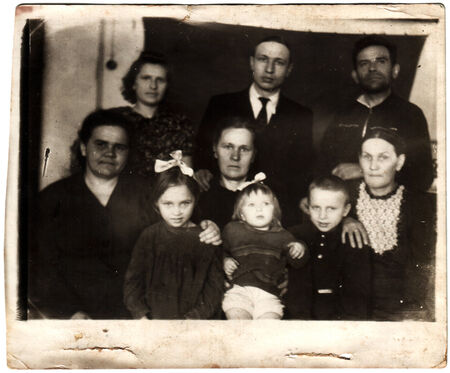 solders: USSR  - CIRCA 1968: An antique photo shows family portreit
