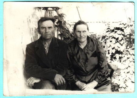 studio b: USSR  - CIRCA 1948: An antique photo shows man and a middle-aged woman sitting in the garden