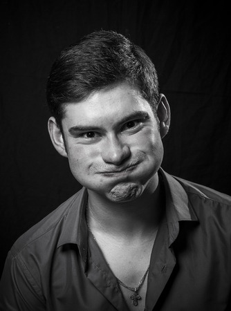 grimacing: portrait of a young man grimacing Stock Photo