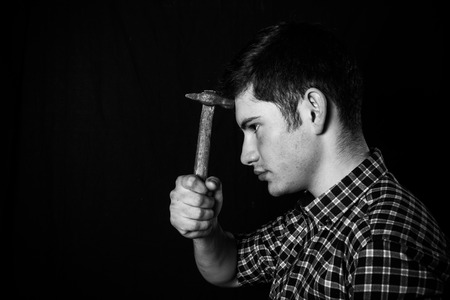 portrait of a young man with a hammer photo
