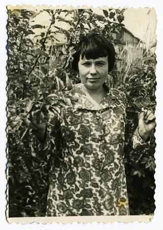 USSR - CIRCA 1930s: Vintage photo shows girl in the garden, 1930s
