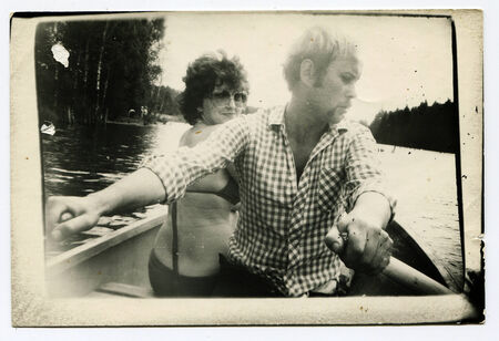 USSR - CIRCA 1970s : An antique photo shows  man and woman traveling by boat