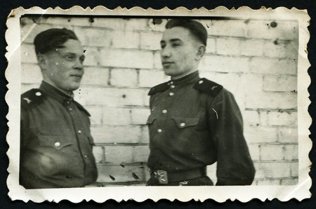 solders: USSR - CIRCA 1953: An antique photo shows two solders Editorial