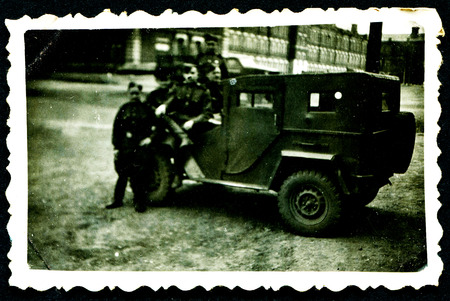 USSR - CIRCA 1953: Postcard shows group of Soviet soldiers against the truck, USSR, 1953