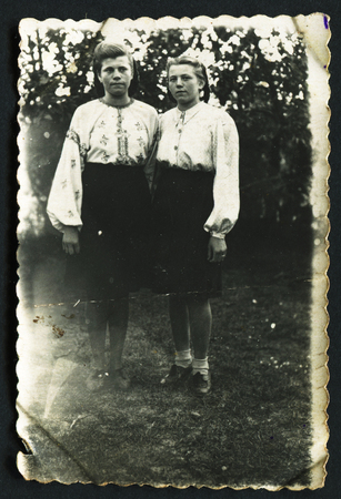 studio b: USSR - CIRCA 1953: Vintage photo shows Portrait of two girls in the garden, 1953 Editorial