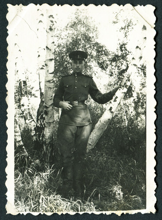 USSR - CIRCA 1953: Postcard shows soldiers among birches, 1953