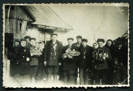 USSR - CIRCA 1953: An antique photo shows group portrait happy people, 1953