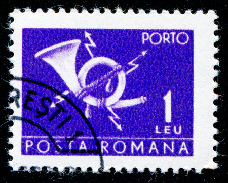 posthorn: ROMANIA - CIRCA 1967: A stamp printed in Romania shows a posthorn, circa 1967.